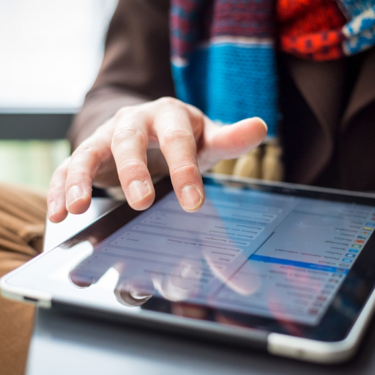 close up of hand and device tablet